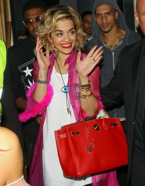 82248, LONDON, UNITED KINGDOM - Friday August 10, 2012. Singer Rita Ora seen wearing a bright pink shirt and thigh high leather boots while leaving with boyfriend Rob Kardashian from the DSTRKT night club in London. ***UK PAPERS OUT***Photograph: ©PacificCoastNews.com **FEE MUST BE AGREED PRIOR TO USAGE****E-TABLET/IPAD & MOBILE PHONE APP PUBLISHING REQUIRES ADDITIONAL FEES*** LOS ANGELES OFFICE:+1 310 822 0419 LONDON OFFICE:+44 20 8090 4079