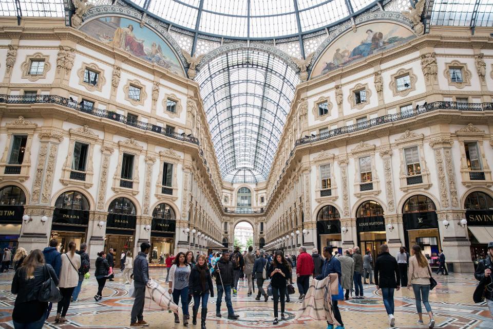 Shoppers at the Galleria Vittorio Emanuele II shopping mall in Milan. Photo Courtesy: Alessia Pierdomenico/Bloomberg