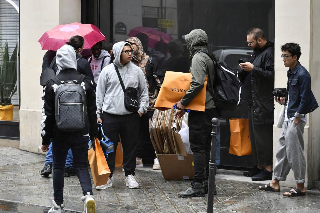 Outside the Louis Vuitton x Supreme launch in Paris. Photo Courtesy: Dominique Maître/WWD