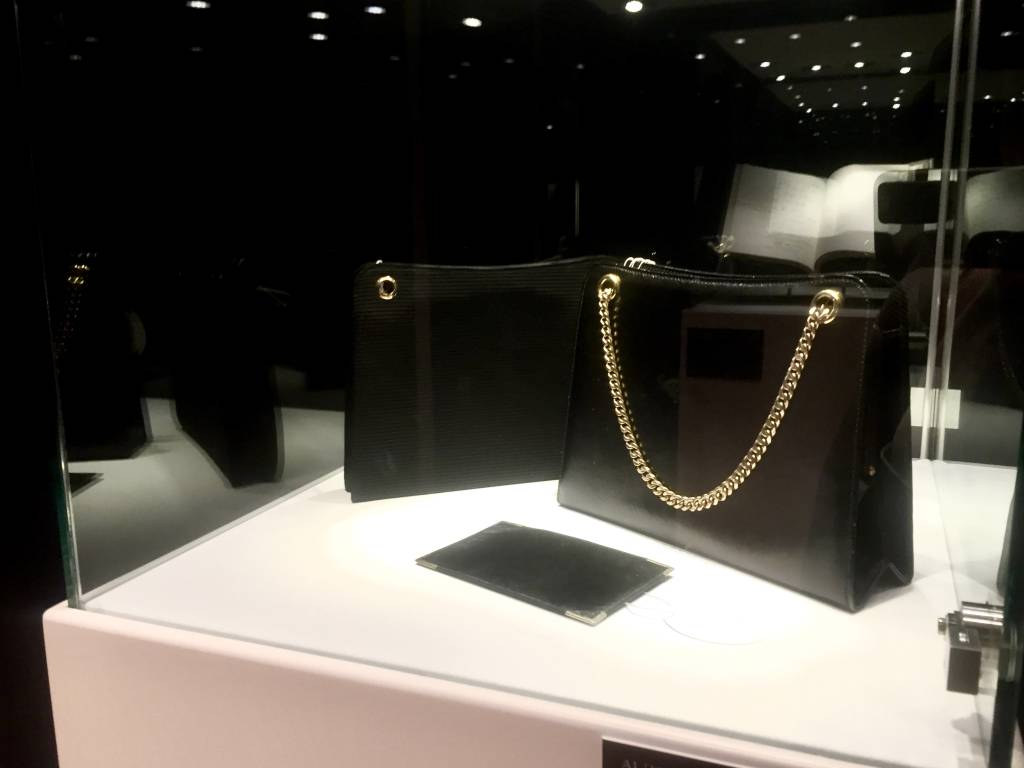 Cartier silk evening bag and Gucci calf leather bag.