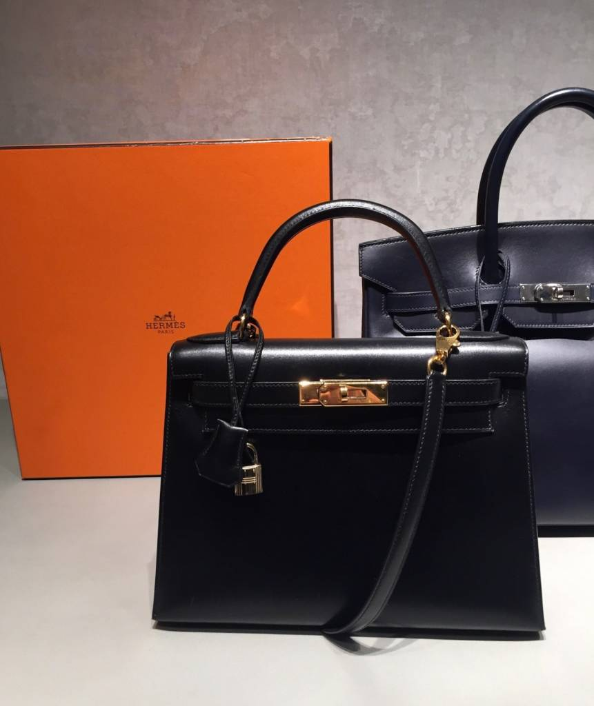 ae1bd91063 BLACK CALF BOX LEATHER SELLIER KELLY 28 WITH GOLD HARDWARE via Christie's.  Click photo for details.