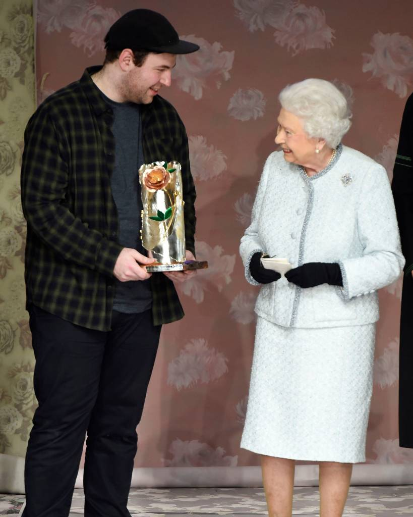 The Queen presents Richard Quinn with the inaugural Queen Elizabeth II award for British design. Photo courtesy: WWD/REX/Shutterstock