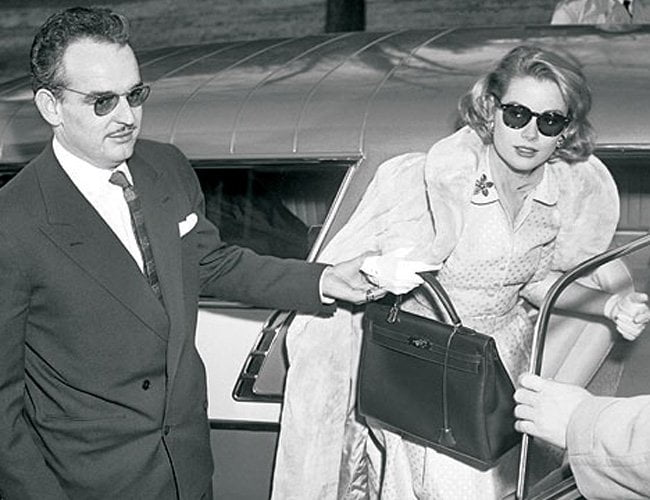 Grace Kelly with her Kelly bag, long before the Birkin was invented