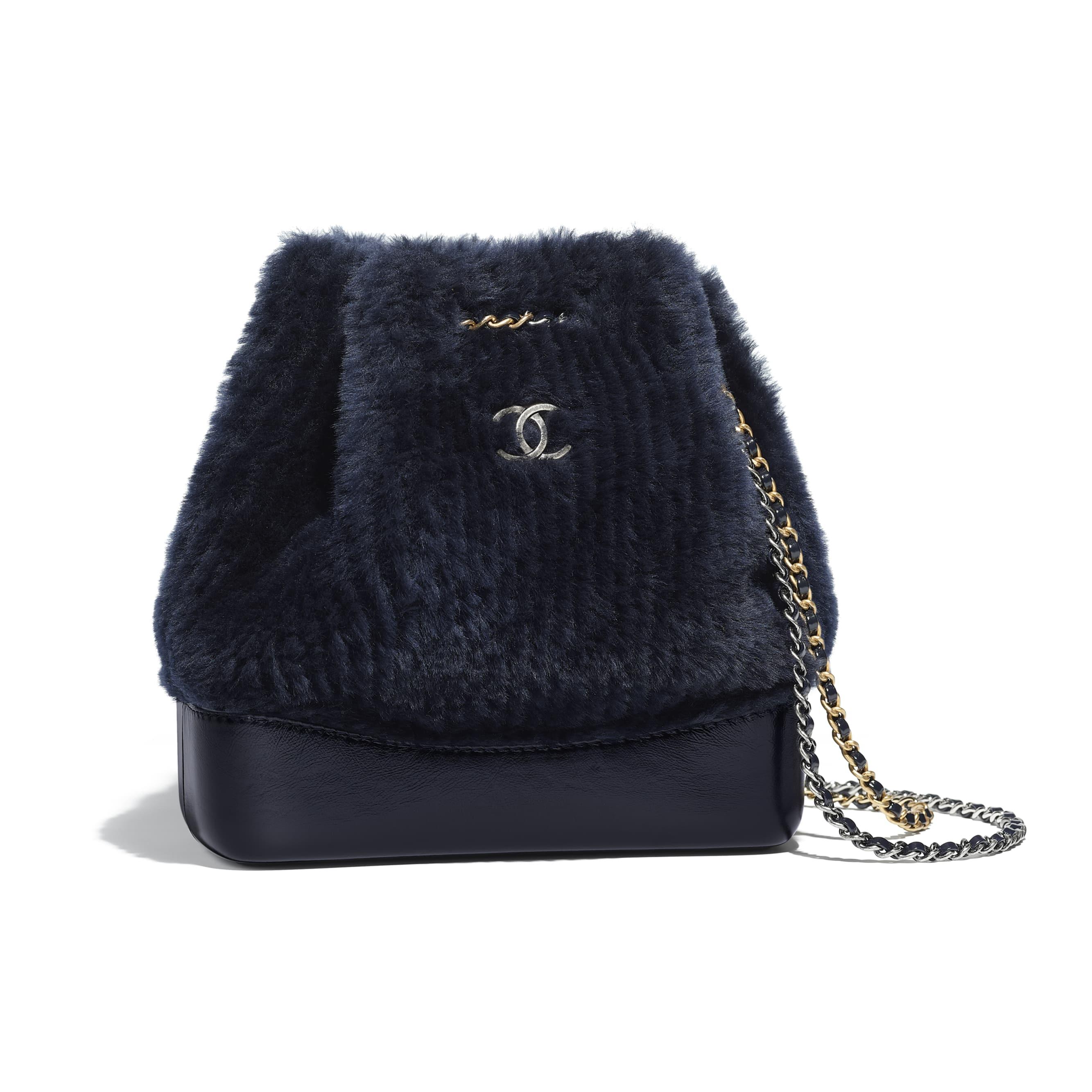a1f8fe54721 chanel -s-gabrielle-small-backpack-navy-blue-shearling-sheepskin-calfskin-silver-tone-gold-tone-metal-packshot-default-a94485y332800b789-8804054892574